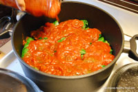 adding pasta sauce