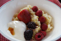 Hot cereal with berries and yogurt