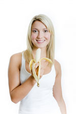 woman holding a banana